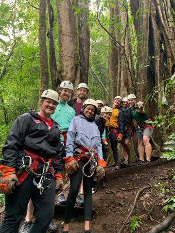 Students in the MBA program at UL Lafayette lined up to go ziplining in Costa Rica